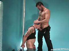 Horny guy with chained hands works his mouth at stiff cock.