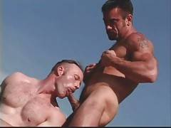 Muscled hairy dude facefucks man while he in his turn gets his dick sucked.