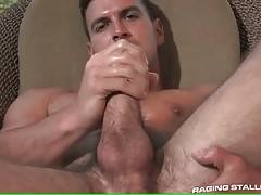 Horny tough guy massages his thick dick and fingers his asshole.